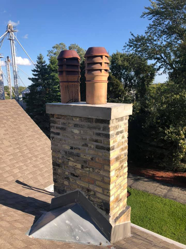 Brick repair and custom flues reused