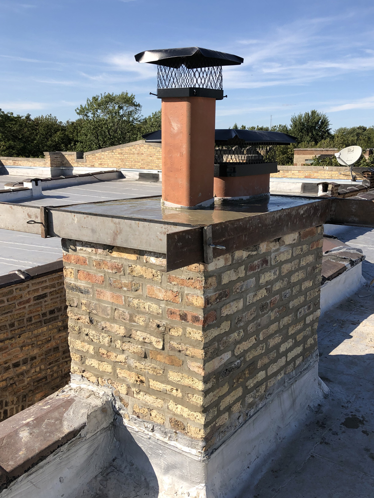 Chimney tiles with new caps and crown
